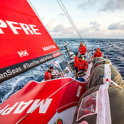 Leg 6 to Auckland, day 18 on board MAPFRE, sailing during the sunset, Louis, Pablo, Rob, Willy and Tamara on deck. 23 February, 2018.
