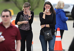 May 3, 2019 - Crystal Lake, IL, USA - Mourners wipe away tears after attending the visitation for 5-year-old Andrew ''AJ'' Freund at the Davenport Family Funeral Home and Crematory on Friday, May 3, 2019, in Crystal Lake, Ill. (Credit Image: © TNS via ZUMA Wire)