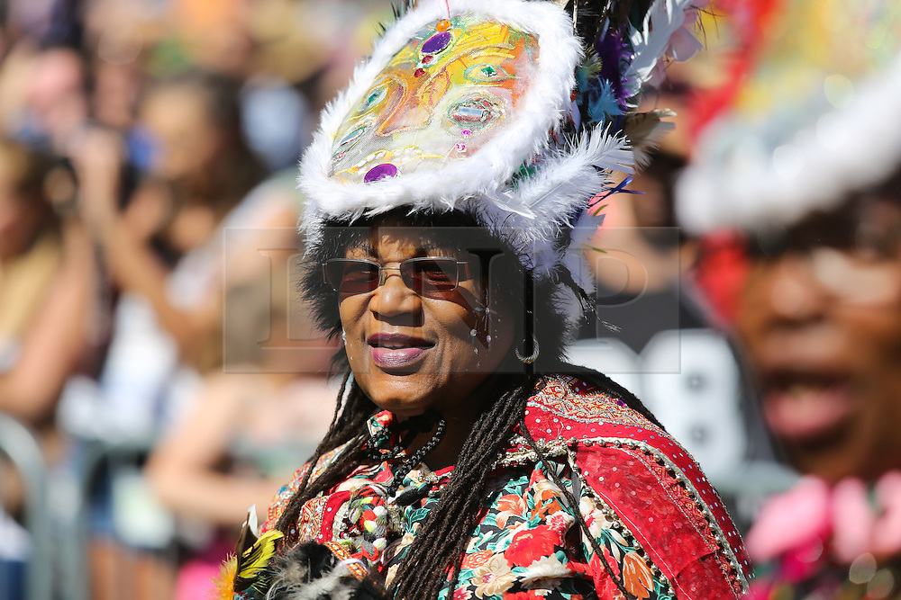© Licensed to London News Pictures. 29/08/2016. Leeds, UK. A woman dressed in a brightly coloured costume at the Leeds West Indian Carnival in Leeds, West Yorkshire. First run in the 1960's, the Leeds West Indian Carnival is Europe's longest running authentic Caribbean carnival parade. Photo credit : Ian Hinchliffe/LNP