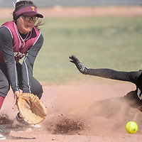 Tohatchi Cougar Megan Woodie (3) reaches for the ball as Raton Tiger Camryn Mileta (27) slides into second base Friday at Tohatchi High School.