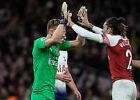 Football - 2018 / 2019 Premier League - Arsenal vs. Tottenham Hotspur<br /> <br /> Bernd Leno (Arsenal FC) and Hector Bellerin (Arsenal FC) celebrate at the final whistle at The Emirates.<br /> <br /> COLORSPORT/DANIEL BEARHAM