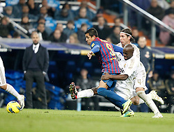 10.12.2011, Santiago Bernabeu Stadion, Madrid, ESP, Primera Division, Real Madrid vs FC Barcelona, 15. Spieltag, im Bild Barcelona's Alexis Sanchez against Real Madrid's Lass Diarra and Sergio Ramos // during the football match of spanish 'primera divison' league, 15th round, between Real Madrid and FC Barcelona at Santiago Bernabeu stadium, Madrid, Spain on 2011/12/10. EXPA Pictures © 2011, PhotoCredit: EXPA/ Alterphotos/ Alvaro Hernandez..***** ATTENTION - OUT OF ESP and SUI *****