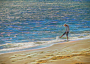 Girl playing in the ocean