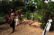Lando Koornduk walks through his ancestors graveyard at Toevlugt, a Cocao plantation in Jodensavanne dating back to the 1700s, Tuesday, September 30, 2003.   (Photographer: Emile Wamsteker)