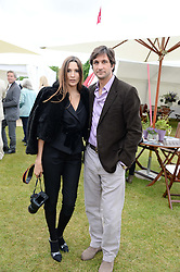 ASTRID MUNOZ  and EDUARDO NOVILLO ASTRADA at the 2013 Cartier Queens Cup Polo at Guards Polo Club, Berkshire on 16th June 2013.