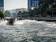 19 JANUARY 2015 - BANGKOK, THAILAND: Passengers boat hauls commuters down Khlong Saen Saeb. The Khlong (canal) was dug in the early 1800s as a way of moving Siamese (Thai) troops from the capital in Bangkok to the Cambodian border. Siam (now Thailand) was at war with Cambodia at the time.     PHOTO BY JACK KURTZ