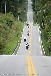 Steve Rinker of West Virginia riding his 1916 Indian leads the pack on this fun rural Missouri road during the Motorcycle Cannonball Race of the Century. Stage-6 from Cape Girardeau, MO to Springfield, MO. USA. Thursday September 15, 2016. Photography ©2016 Michael Lichter.