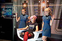 An attendee has their picture taken with Star Trek girls promoting a new game at the Electronic Entertainment Expo  June 5, 2012 at the Los Angeles Convention Center. Copyright 2012 by David Sprague