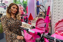 Reality TV star Amy Childs poses with her collection of prams which includes a 'unisex' set at the Toy Fair at Kensington Olympia in London, the UK's largest dedicated game and hobby exhibition featuring the hottest and most anticipated products for the year ahead. London, January 22 2019.
