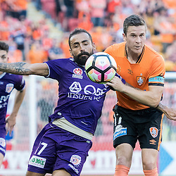 BRISBANE, AUSTRALIA - OCTOBER 30: Matt McKay of the roar heads the ball amidst pressure from Diego Castro of the Glory during the round 4 Hyundai A-League match between the Brisbane Roar and Perth Glory at Suncorp Stadium on October 30, 2016 in Brisbane, Australia. (Photo by Patrick Kearney/Brisbane Roar)