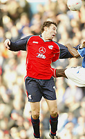 PORTSMOUTH 2 V SCUNTHORPE UNITED 1.     24.1.04. <br /> SCUNTHORPE'S STEVE TORPEY WINS A HIGH BALL IN THE BOX AND JUST GOES OVER THE BAR AGAINST PORTSMOUTH IN THE F.A. CUP FOURTH ROUND MATCH AT FRATTON PARK.<br /> PIC BY HARRY HERD/SPORTSBEAT IMAGES