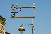 Last remaining street light from Jaffa's first power line inaugurated in 1923. This historical monument stands on the corner of Raziel (Boustrus-Howard) and Hadoar streets in Jaffa, Israel