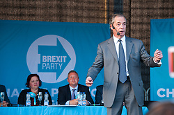 © Licensed to London News Pictures. 15/05/2019. Merthyr Tydfil, Powys, Wales, UK. Nigel Farage speaks to Brexiteers at an outdoor Brexit Party rallyin Wales which takes place at Trago Mills in  the Welsh, former mining town, of Merthyr Tydfil in Powys, UK. The Brexit Party was founded by former UKIP economics spokeswoman, Catherine Blaiklock in January 2019 to support the winning Brexit vote in the 'Leave or Remain' referendum of 23rd June 2016. Brexit Party members point out that the UK prime minister, Theresa May, has betrayed her electorate by not keeping her pledge that the UK would leave the European Union on March 29th 2019, the date set by invoking article 50 of the Treaty of Lisbon. Photo credit: Graham M. Lawrence/LNP