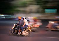 HANOI, VIETNAM - CIRCA SEPTEMBER 2014:  Motorbike rushing in the streets of the Old Quarter at night in Vietnam.