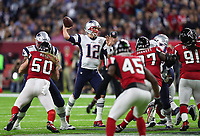 New England Patriots quarterback Tom Brady (12) looks to pass during the NFL Super Bowl LI football game  against the Atlanta Falcons on Sunday, Feb. 05, 2017 in Houston. The Patriots defeated the Falcons 34-28 in overtime.<br /> <br /> (Tom DiPace )