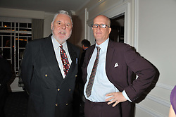 Left to right, TERRY WAITE and TOM KENYON-SLANEY at a dinner in aid of the charity Save The Rhino held at ZSL London Zoo, Regents Park, London on 16th October 2012.