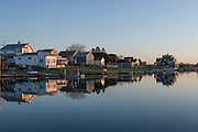 Sunrise on cottages by the water in East Matunuck, in South Kingstown, Rhode Island.
