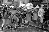 Peace People March along the Falls Road, Belfast, N Ireland, UK, 23rd October 1976 - woman opponent of the Peace March lashes out with a horse whip at one of the marchers. 197610230506d<br />