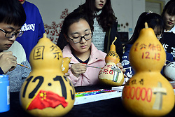 December 13, 2016 - Liaochen, Liaochen, China - Liaocheng,CHINA-December 13 2016: (EDITORIAL USE ONLY. CHINA OUT) ..Students from Liaocheng University paint guards commemorating victims of Nanjing Massacre in Liaocheng, east China's Shandong Province, December 13th, 2016. (Credit Image: © SIPA Asia via ZUMA Wire)