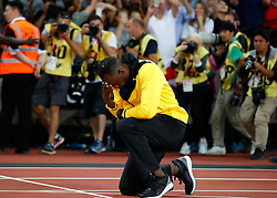 LONDON, Aug. 14, 2017  Usain Bolt of Jamaica kneels at the start line of 100m on Day 10 of the 2017 IAAF World Championships at London Stadium in London, Britain, on Aug. 13, 2017. (Credit Image: © Wang Lili/Xinhua via ZUMA Wire)