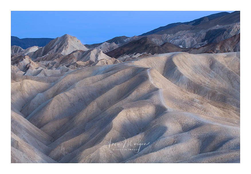 Landscape view of blue twilight at Zabriskie Point showing mountains in background, Death Valley National Park, California