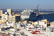 Rooftops of buildings looking towards the cruise ship in port from cathedral roof, Cadiz, Spain