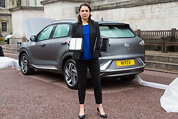 Sylvie Childs, Senior Product Manager at Hyundai UK shows the comparison between a new clean air filter and a dirty one as  Hyundai UK demonstrates the Hydrogen-powered Nexo that not only produces completely clean emissions but also cleans up the air its engine ingests, thanks to a filtration system developed by scientists at University College London. UCL London, October 17 2018.