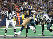 St. Louis Rams' runningback Steven Jackson (39) brakes up the middle for a touchdown against the Philadelphia Eagles at the Edward Jones Dome in St. Louis, Missouri on December 27, 2004.