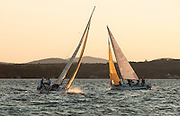 It approached the golden hour as two J80 sailboats compete in the Thursday night race series out of Winnipesaukee Yacht Club.  (Karen Bobotas/for the Laconia Daily Sun)