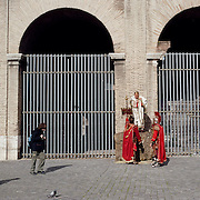 Men dressed in Roman costumes wait for tourists to pay for photographs with them outside the Colosseum in the centre of the city of Rome, Italy. 23rd July 2011. Photo Tim Clayton