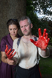 Pictured:  <br /> Bard in the Botanics . The latest production features a version of Macbeth set in 1950s, directed by Gordon Barr. Kirk Bage (Macbeth) and Nicole Cooper (Lady Macbeth) have blood on their hands as they perform the murder of Duncan scene on the main stage<br /> Karen Gordon  (c) Edinburgh Elite media Date<br /><br /><br />(c) Karen Gordon   Edinburgh Elite media