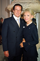 Actor ROGER MOORE and his close friend MRS KIKI <br /> THOLSTRUP, at a reception in London on 12th July 2000.OGG 7<br /> © Desmond O'Neill Features:- 020 8971 9600<br />    10 Victoria Mews, London.  SW18 3PY <br /> www.donfeatures.com   photos@donfeatures.com<br /> MINIMUM REPRODUCTION FEE AS AGREED.<br /> PHOTOGRAPH BY DOMINIC O'NEILL