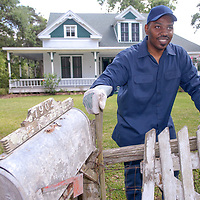Sam Collins III stands in front of the restored house that will host a Juneteenth celebration on June 14 in Hitchcock.