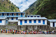 Patients form a long line as they wait to enter the triage area of the Himalayan Family Healthcare Project medical camp in Thonche, Nepal. Some patients came from the town of Thonche, population 170, and others walked several hours from nearby villages to visit the clinic.