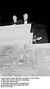 Jasper Judd & Simon Matthews getting in to the Trinity College May Ball via the roof. Cambridge. 15 june 1981. film 8135f4<br />© Copyright Photograph by Dafydd Jones<br />66 Stockwell Park Rd. London SW9 0DA<br />Tel 0171 733 0108