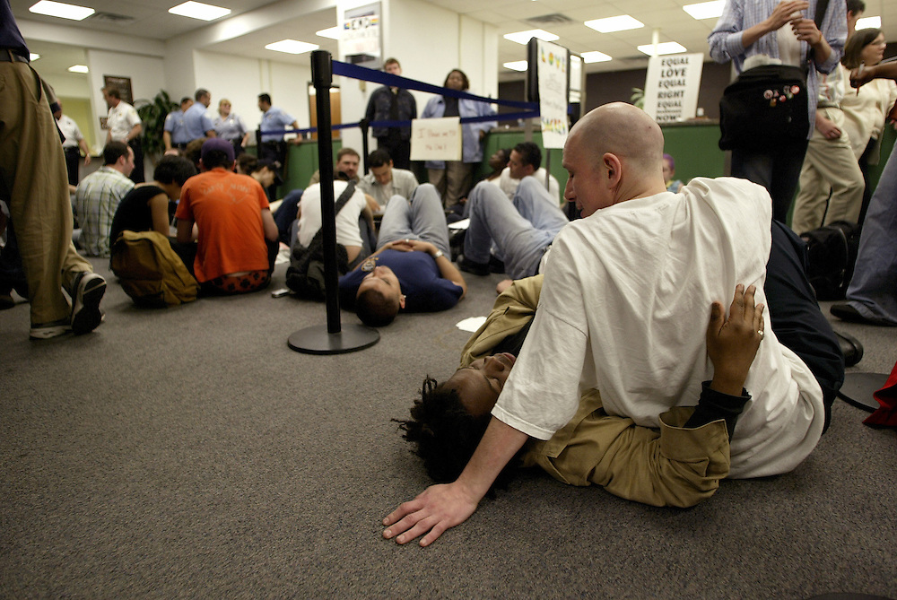 Gay marriage rights demonstrators including Gary Naham, right, and T.J. Williams stage a sit-in at the office of Cook County Clerk David Orr Monday afternoon after being denied marriage licenses.