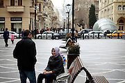 Teenagers chat on a pedestrian street in downtown. Azeri GDP grew 41.7% in the first quarter of 2007, possibly the highest of any nation worldwide, as the country economy completed its post-Soviet transition into a major oil based economy.<br /> Baku was awarded the right to host of the first European Games, a multi-sport event.