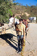 Work Family Guest Ranch, San Miguel, California offers horseback rides through the hills on the 12,000 acre property.  Ranch hand Jennifer Brawley with her horse.