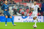 John Brooks (USA) & Callum Wilson (England) during the international Friendly match between England and USA at Wembley Stadium, London, England on 15 November 2018.