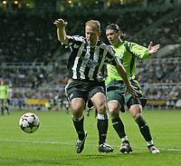 Photo. Andrew Unwin, Digitalsport<br /> Newcastle United v Sporting Lisbon, Uefa Cup Quarter Final First Leg, St James' Park, Newcastle upon Tyne 07/04/2005.<br /> Newcastle's Alan Shearer (L) battles with Sporting's Anderson Polga (R).