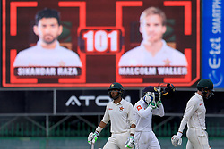 July 16, 2017 - Colombo, Sri Lanka - Zimbabwe cricketer Sikandar Raza (L),  Malcolm Waller (R) and Sri Lankan wicket keeper Niroshan Dickwella(M) are seen next to the digital score board after the Zimbabwe pair scored a 100 run partnership during the third day's play of the only test cricket match between Sri Lanka and Zimbabwe in Colombo, Sri Lanka, Sunday, July 16, 2017. (Credit Image: © Tharaka Basnayaka/NurPhoto via ZUMA Press)