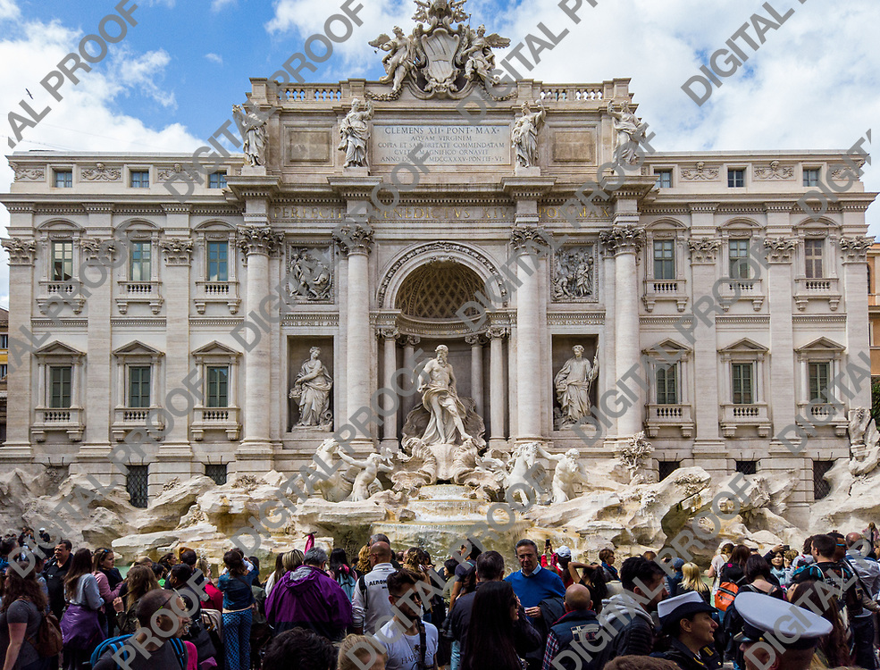Trevi fountain also known as fontana di trevi (in Italian) surrounded by tourists during the day