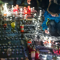 Participant lights a candle to show support for the terrorist attack victim staff of the Charlie Hebdo satirical weekly in front of the French Embassy in Budapest, Hungary on January 09, 2015. ATTILA VOLGYI