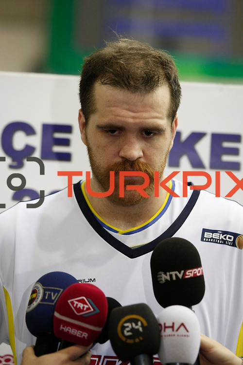 Fenerbahce Ulker's Oguz Savas during their Turkish Basketball league derby match  Fenerbahce Ulker between Anadolu Efes at Caferaga Sports Hall in Istanbul, Turkey, Saturday 01, 2012. Photo by TURKPIX