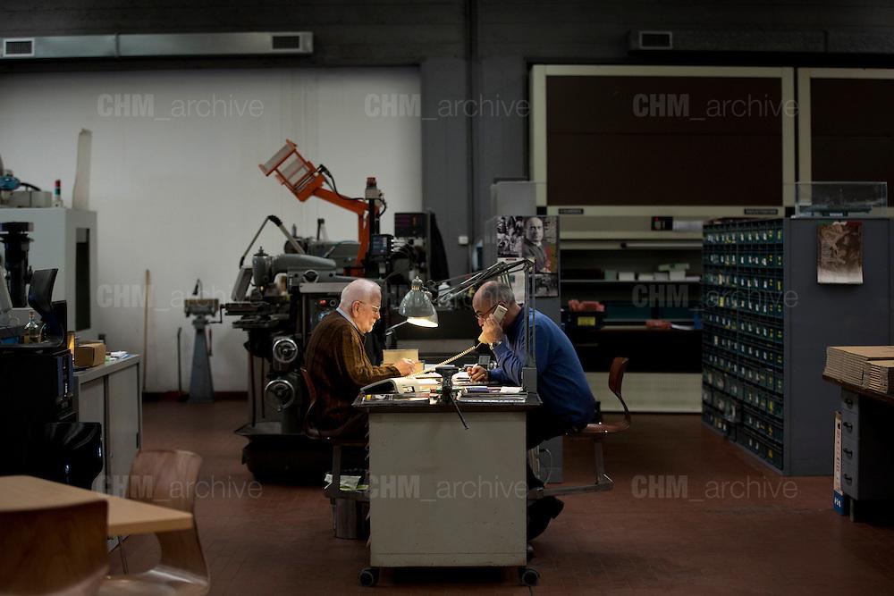 Carlo Vichi, fondatore della Mivar, parla con un tecnico all'interno della sua fabbrica, Abbiategrasso 18 marzo 2014. Guido Montani / OneShot