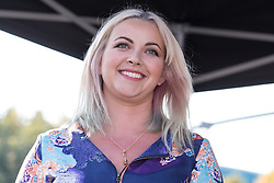 © Licensed to London News Pictures . 04/10/2015 . Manchester , UK .  CHARLOTTE CHURCH speaks in front of people at a demonstration against the Conservative government , organised by The People's Assembly , through Manchester City Centre , during the first day of the Conservative Party Conference in Manchester . Photo credit: Joel Goodman/LNP