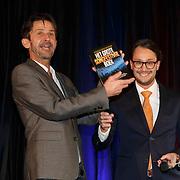 NLD/Amsterdam/20150324 -  boekpresentatie Het Grote Songfestival boek, Dave Boomkens reikt het eerste boek uit aan Cornald Maas