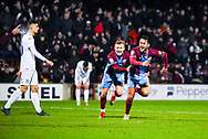 Levi Sutton of Scunthorpe United (22) scores a goal and celebrates with George Thomas of Scunthorpe United (18) to make the score 2-0 during the EFL Sky Bet League 1 match between Scunthorpe United and Coventry City at Glanford Park, Scunthorpe, England on 5 January 2019.
