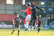 Scunthorpe United Myles Hippolyte (15) Salford City Jason Lowe (4) battles for possession during the EFL Sky Bet League 2 match between Salford City and Scunthorpe United at the Peninsula Stadium, Salford, United Kingdom on 6 March 2021.
