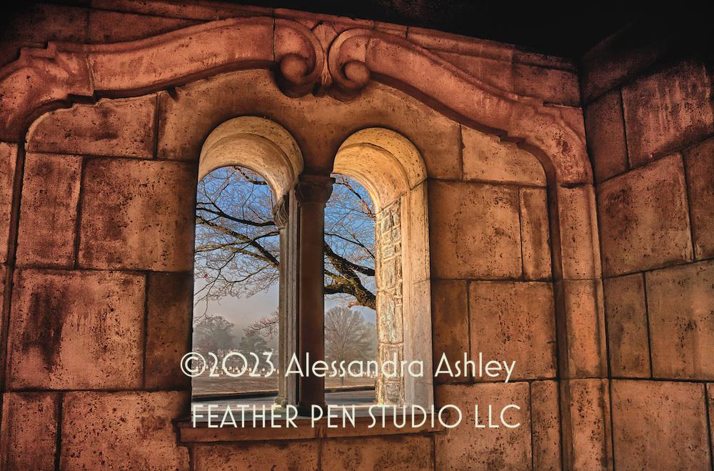 View through courtyard window to gently rolling hills of historic cemetery.  Atlanta, Georgia, USA.